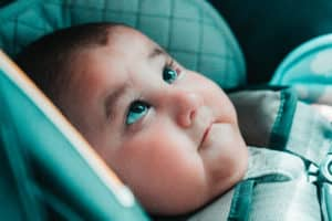 Baby in a car seat looking up