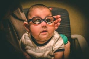 Baby Nathan wearing glasses